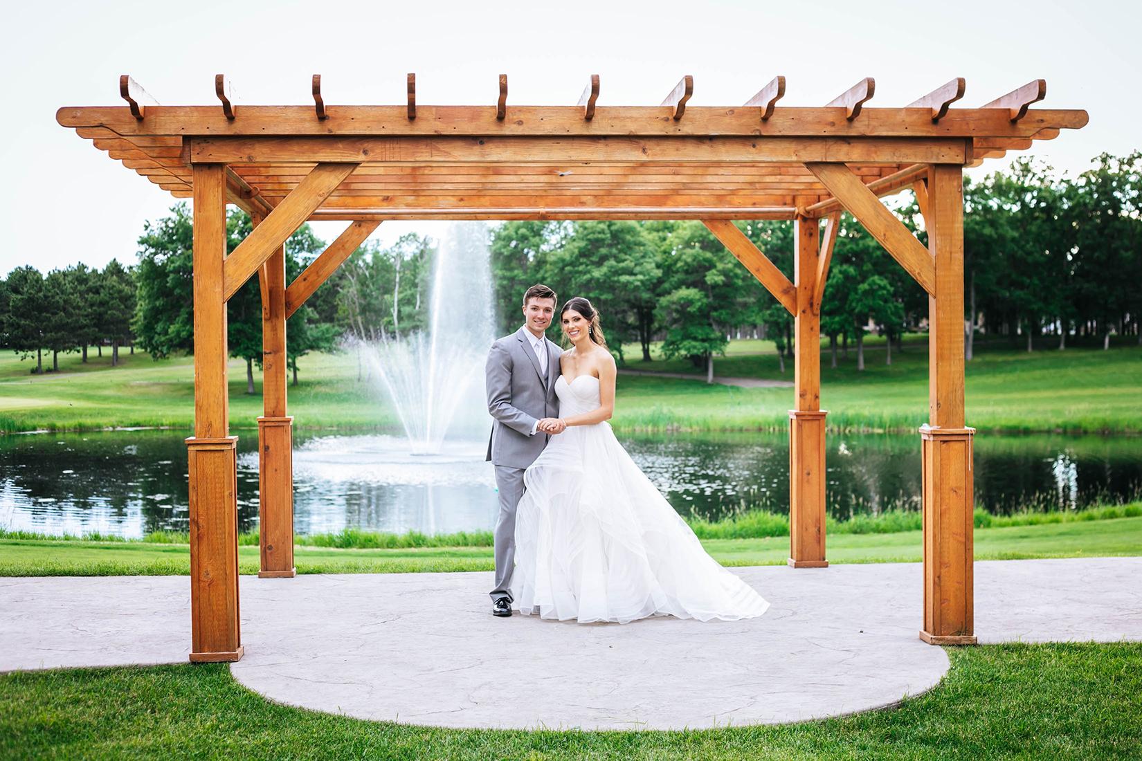Wedding couple under the pergola at Thumper Pond